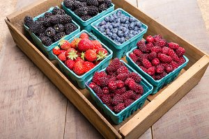Wooden crate of fresh berries