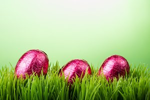 Background three pink eggs