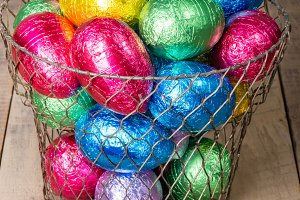 Wire basket of candy eggs