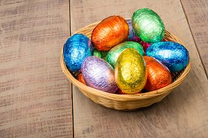 Wicker basket of candy eggs
