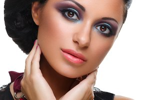 Beautiful girl with bright vivid purple and green make-up
