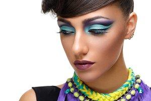 Beautiful girl with bright vivid purple make-up