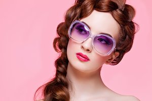 Beautiful girl with bright make-up and sunglasses