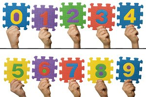 Children hands holding numbers.