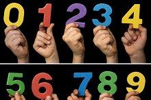 Children hands holding numbers.