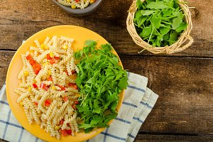 Pasta salad with vegetable and arugula salad with olive oil