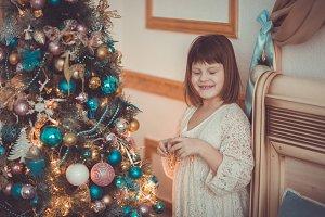 Christmas dream, girl near tree