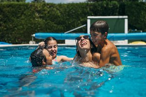 Young friends having fun in the pool