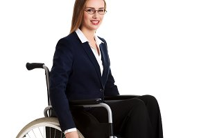 Businesswoman sitting in a wheel chair