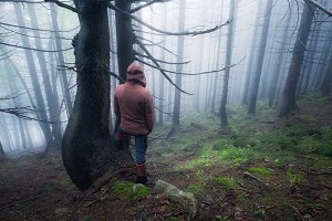 Man in a foggy forest