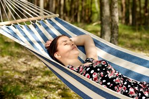 Woman relaxing in the hammock