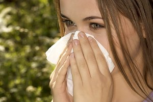 Attractive young woman outdoor with white tissue