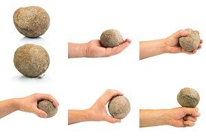 Hand holding stone ball