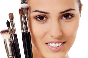 Beauty woman with makeup brushes in natural make-up