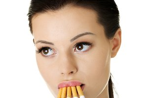 Young beautiful woman holding cigarette.