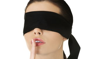 Confused blindfolded woman