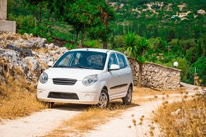 White car on a mountain road