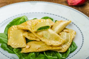 Homemade ravioli stuffed with spinach and ricotta