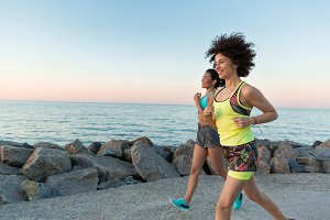 Happy smiling fitness women jogging together