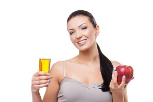 Beautiful girl with apple and glass of juice