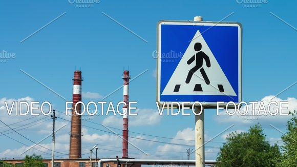 Timelapse Road Sign Of A Pedestrian Walkway In The Background Of A Plant With Pipes Urban Landscape Rules Of The Road Regulation Of The Automobile Flow Traffic Of Cars Industrial Area Safe Passage Of Pedestrians Across The Road Car Traffic
