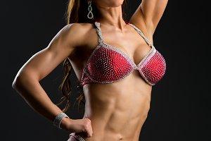 Bikini fitness girl in red swimsuit