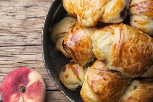 Tasty croissants with peaches
