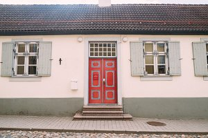 Red door vintage facade building