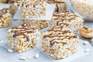 Homemade bars with crispy rice, honey and peanut butter, horizontal