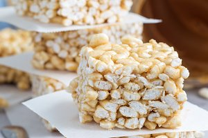 Homemade bars with crispy rice, honey and peanut butter, vertical