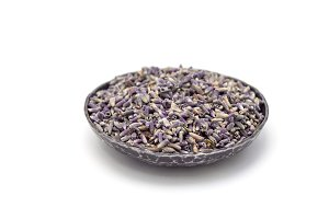 Dry lavender tea on metall plate, isolated on white background