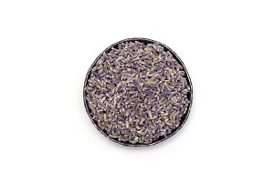 Dry lavender tea on metall plate, isolated on white background, top view