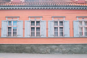 Peach building and pale blue windows
