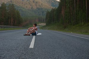 Man sitting on the road