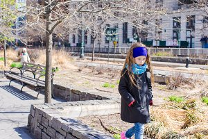 Adorable little girl walking at New York City outdoor