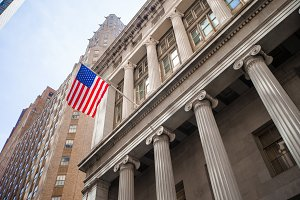 New York Stock Exchange in Manhattan Finance district. View of the building in the sky