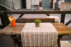 Outdoor cafe with rustic table