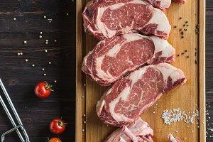 Fresh raw beef on the wood board