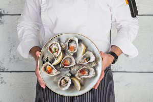 Chef keeps a plate oysters upright