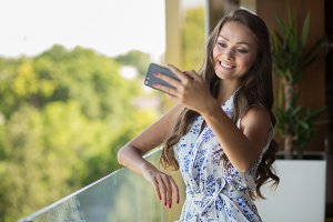 Young beautiful woman take selfie
