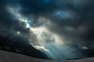 Rising sun through clouds