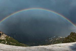 Rainbow over mountain.