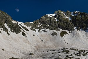 Moon rises over snow pass