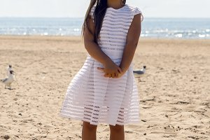 portrait of a tanned girl on the sandy beach