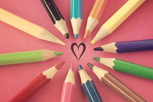 Painted heart and crayons