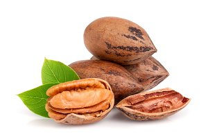 heap of pecan with leaves isolated on white background