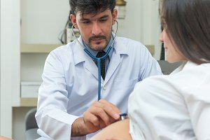 doctor and pregnant by stethoscope