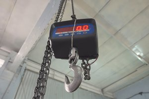 Industrial scales under ceiling in warehouse - chain block