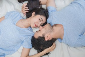 Young couple sleeping on the bed