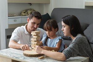 happy family playing wooden blocks